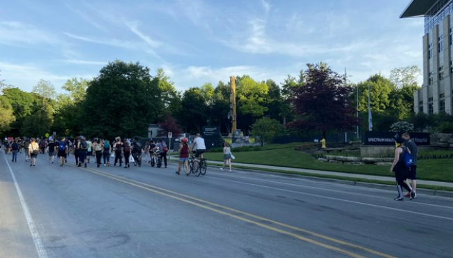 Protesters march in East Grand Rapids  after downtown demonstration on June 3, 2020.