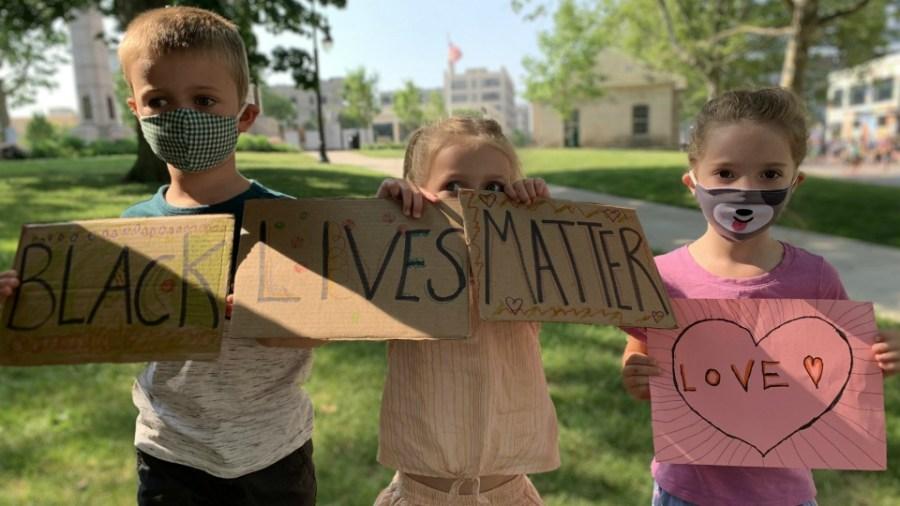 Kids attend Black Lives Matter march in Grand Rapids on June 20, 2020.