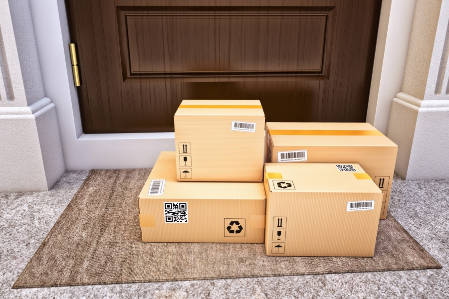 Four large boxes sitting on run outside of house