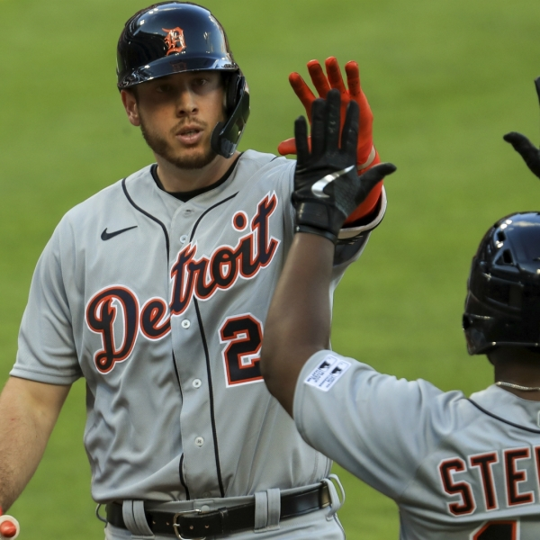 Detroit Tigers' C.J. Cron (26) celebrates with Christin Stewart (14) after hitting a solo home run in the fourth inning of a baseball game against the Cincinnati Reds at Great American Ballpark in Cincinnati, Friday, July 24, 2020. (AP Photo/Aaron Doster)