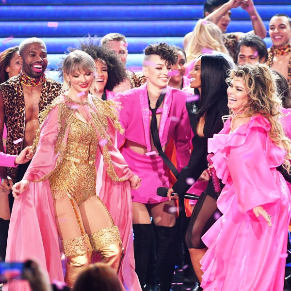 2019 American Music Awards hosted by Ciara. Taylor swift on stage celebrating wearing pink with confetti falling down on stage