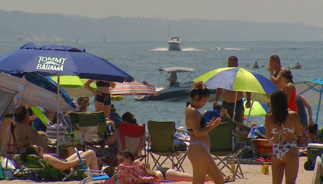 People flock to the beach at Grand Haven State Park on July 3, 2020.