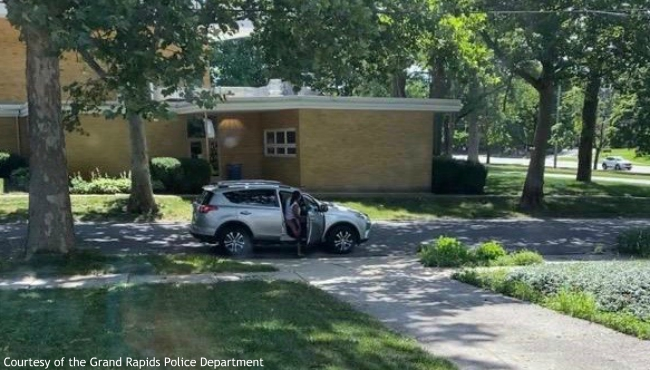 A photo of a suspect getting into a vehicle outside one of the city officials homes. (Courtesy of the Grand Rapids Police Department)