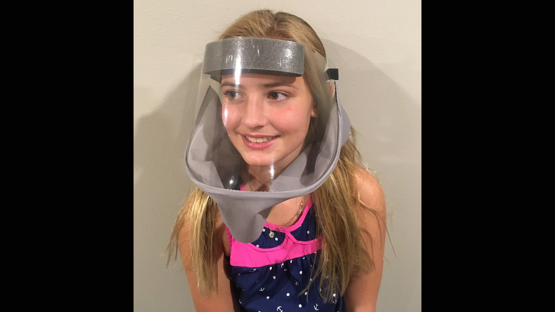 A reusable face shield made for children made by Barber Packaging.