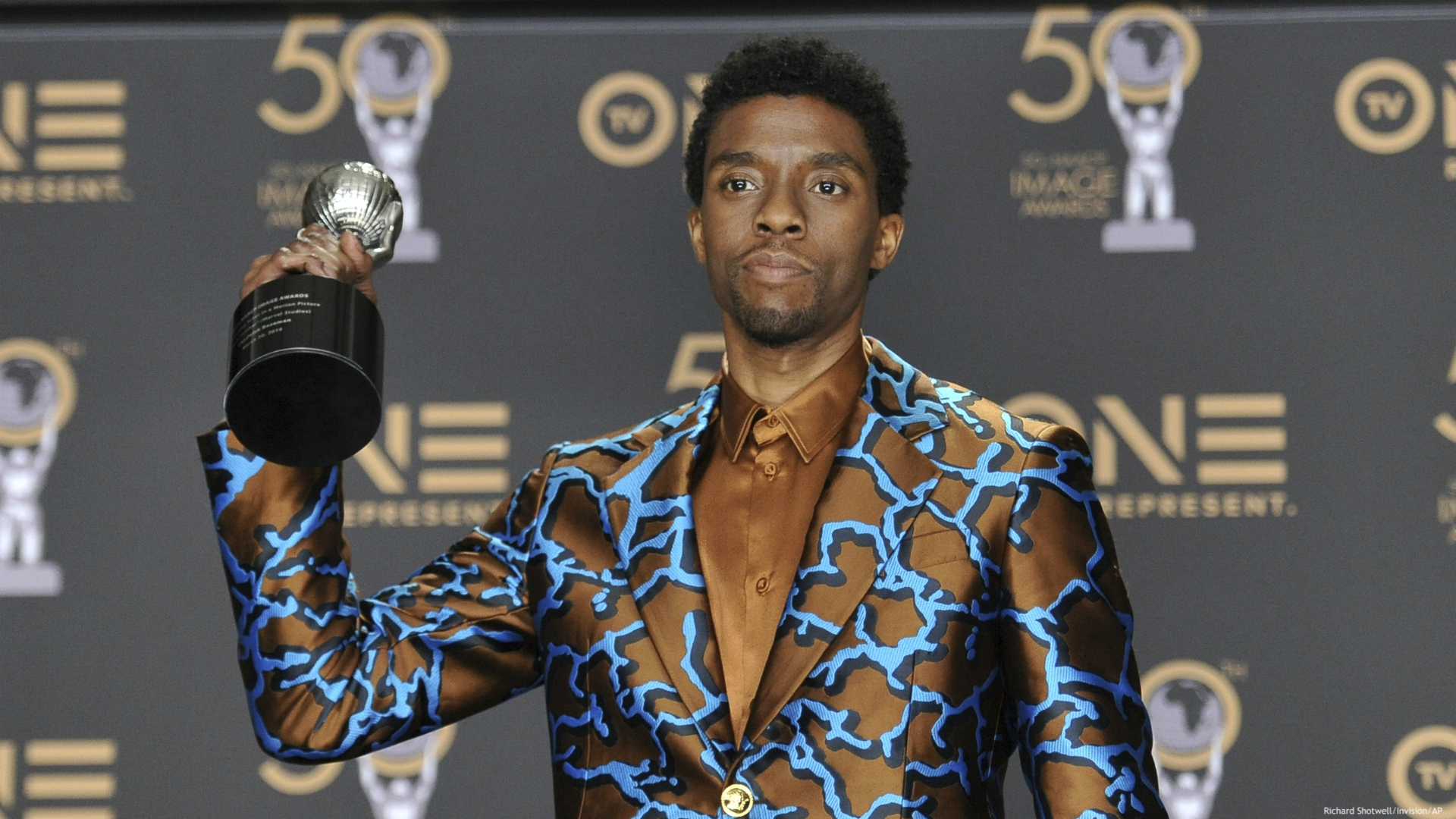 """In this Saturday, March 30, 2019 file photo, Chadwick Boseman poses in the press room with the award for outstanding actor in a motion picture for """"Black Panther"""" at the 50th annual NAACP Image Awards at the Dolby Theatre in Los Angeles. Actor Chadwick Boseman, who played Black icons Jackie Robinson and James Brown before finding fame as the regal Black Panther in the Marvel cinematic universe, has died of cancer. His representative says Boseman died Friday, Aug. 28, 2020 in Los Angeles after a four-year battle with colon cancer. He was 43. (Photo by Richard Shotwell/Invision/AP, File)"""