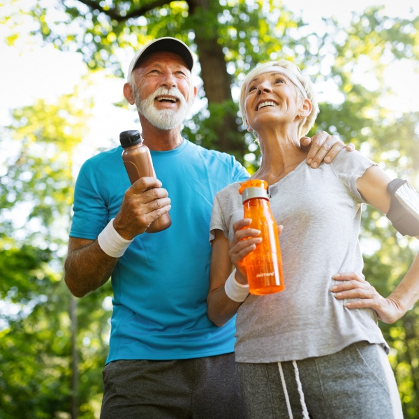 Senior couple staying hydrated after workout outdoor