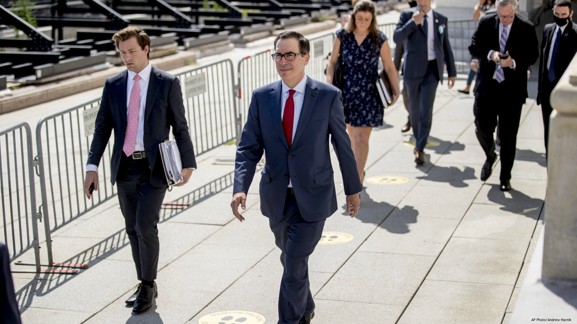 Treasury Secretary Steven Mnuchin, center, and President Donald Trump's Chief of Staff Mark Meadows, second from right, leave following a meeting with House Speaker Nancy Pelosi of Calif. and Senate Minority Leader Sen. Chuck Schumer of N.Y. as they continue to negotiate a coronavirus relief package on Capitol Hill in Washington, Friday, Aug. 7, 2020. (AP Photo/Andrew Harnik)