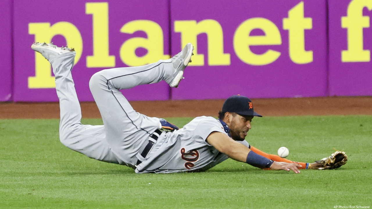 Detroit Tigers' Victor Reyes makes a diving attempt on a single by Cleveland Indians' Greg Allen during the eighth inning of a baseball game, Saturday, Aug. 22, 2020, in Cleveland. (AP Photo/Ron Schwane)