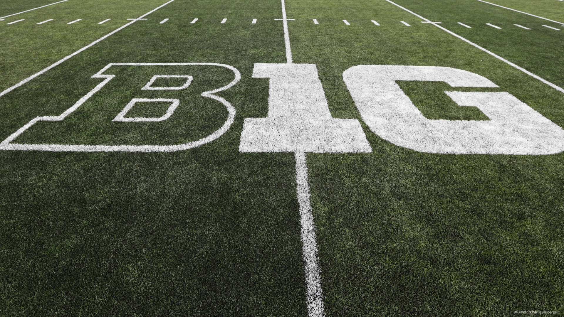 In this Aug. 31, 2019, file photo, the Big Ten logo is displayed on the field before an NCAA college football game between Iowa and Miami of Ohio in Iowa City, Iowa. Big Ten presidents voted 11-3 to postpone the football season until spring, bringing some clarity to a key question raised in a lawsuit brought by a group of Nebraska football players. The vote breakdown was revealed Monday, Aug. 31, 2020, in the Big Ten's court filing in response to the lawsuit. (AP Photo/Charlie Neibergall, File)