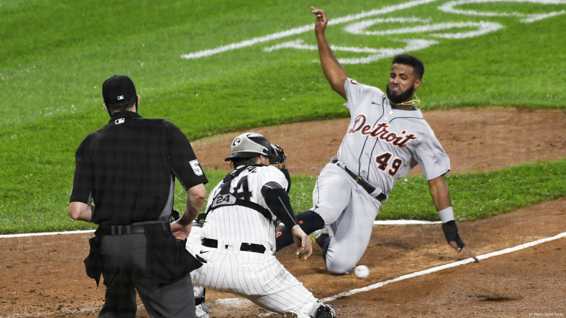 Chicago White Sox catcher Yasmani Grandal (24) prepares to tag Willi Castro (49) out at home plate during the fourth inning of a baseball game, Saturday, Sept.12, 2020, in Chicago. (AP Photo/David Banks)
