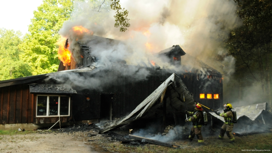 Crews battle a house fire in Van Buren County's Geneva Township on Sept. 15, 2020.