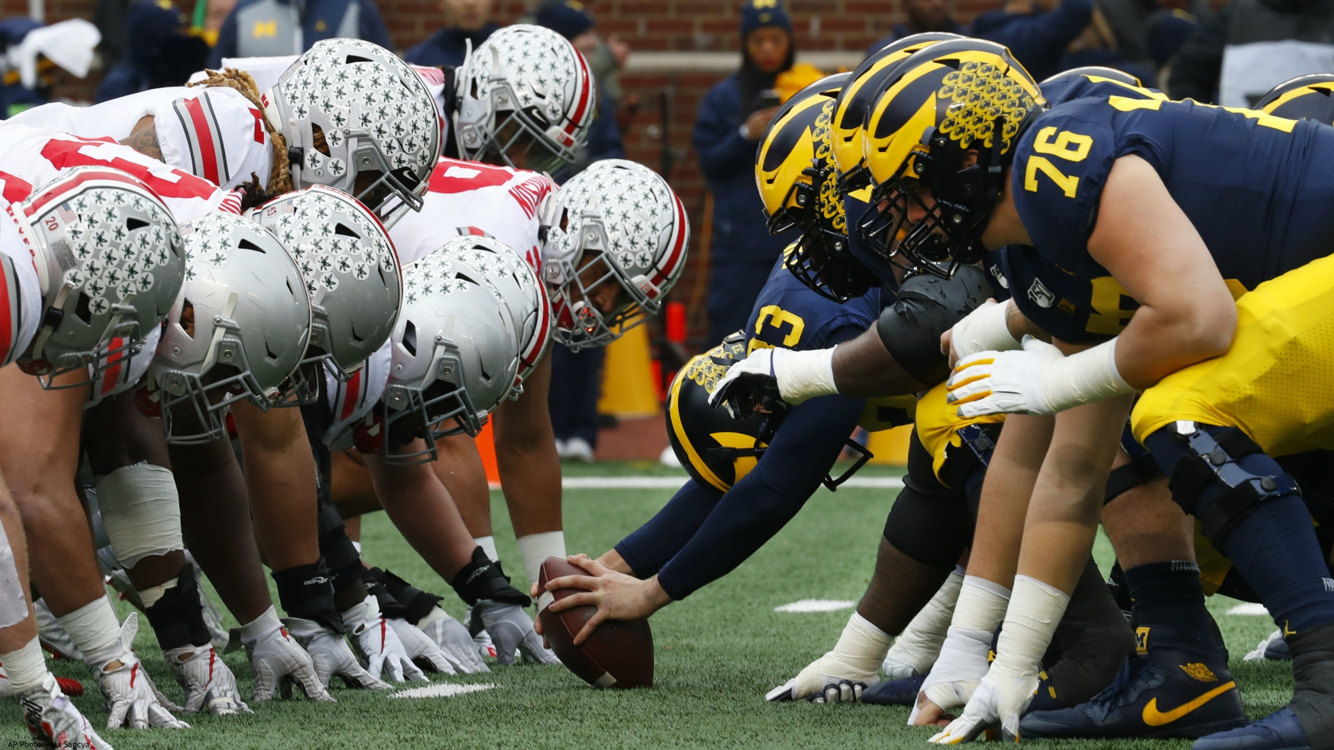 In this Nov. 30, 2019, file photo, Ohio State, left, and Michigan players line up at the line of scrimmage in the first half of an NCAA college football game in Ann Arbor, Mich. The Big Ten's third football schedule of the 2020 season is highlighted by Michigan-Ohio State on Dec. 12, the final day of the conference's regular-season and the latest date the rivals have ever played.(AP Photo/Paul Sancya, File)