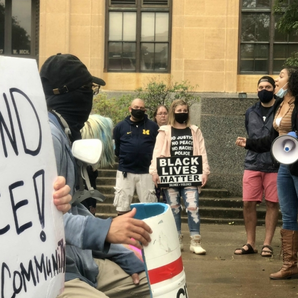 Activists protest Kalamazoo Department of Public Safety for their handling of last month's Proud Boys rally that turned violent. (Sept. 12, 2020)