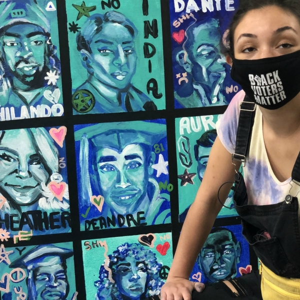 Artist and activist Maya James of Kalamazoo next to her mural on Oct. 10, 2020.