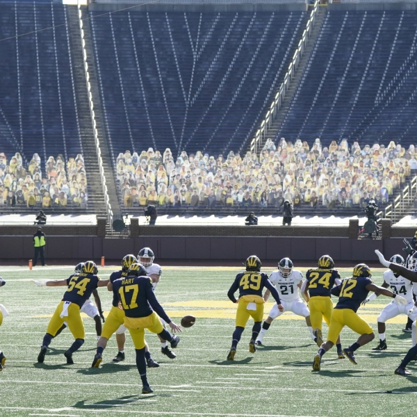 Michigan punter Will Hart (17) kicks to Michigan State during the first half of an NCAA college football game, Saturday, Oct. 31, 2020, in Ann Arbor, Mich. (AP Photo/Carlos Osorio)