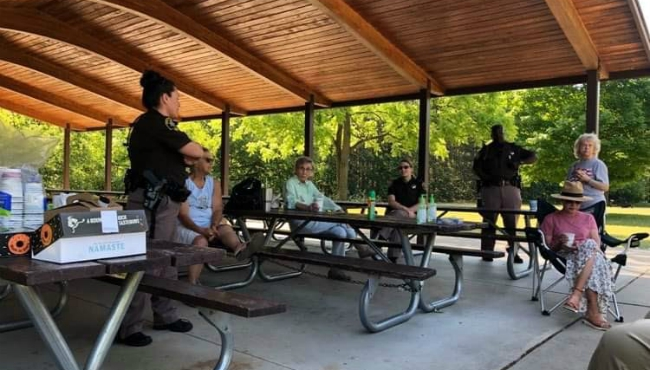 The Coffee with a Deputy group gathers at a park.