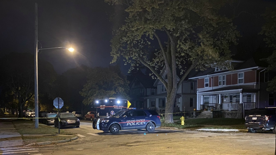Authorities on the scene of an incident near the intersection Sigsbee Street SE and Benjamin Avenue SE in Grand Rapids Wednesday, Oct. 28, 2020.