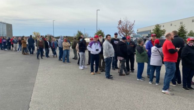 People line up before Vice President Mike Pence visits the Lacks Enterprises, Inc. facility on Kraft Avenue on Oct. 14, 2020.