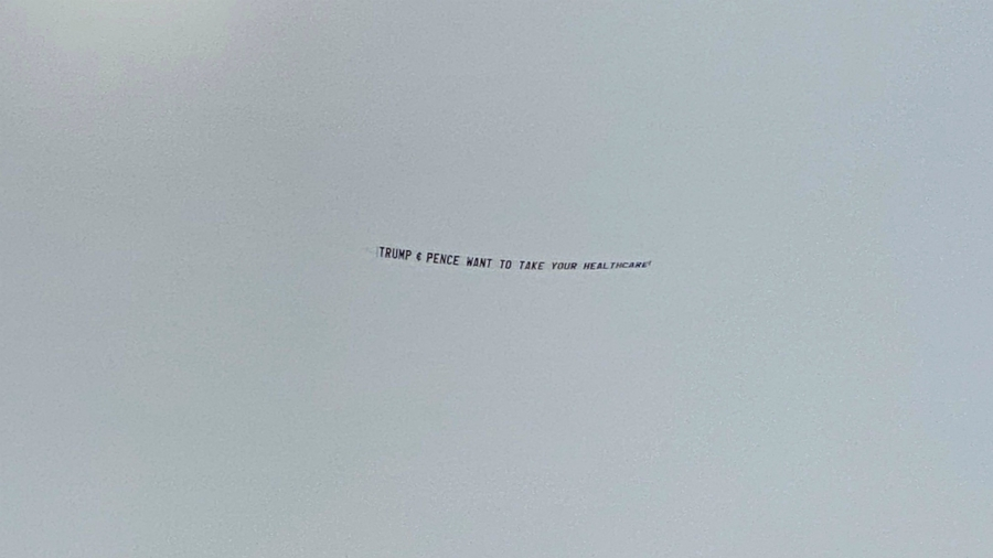 "Plane flying with a ""Trump & Pence want to take your healthcare"" banner over Mike Pence rally near Grand Rapids on Oct. 14, 2020."