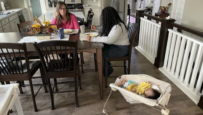 Ardy Berens sits withSophia Coleman while babyJamia is beside her.