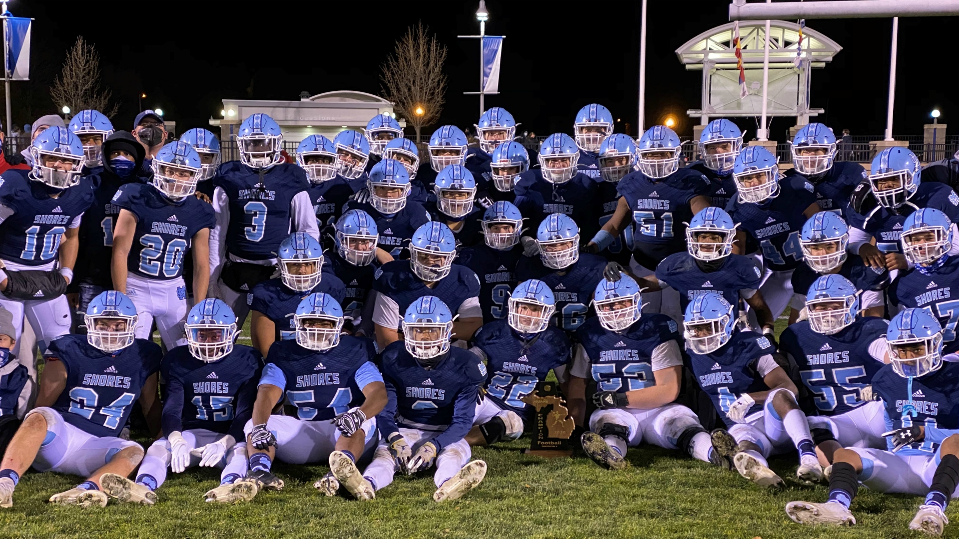 A photo after the Mona Shores football team wins the district title on Nov. 13, 2020.