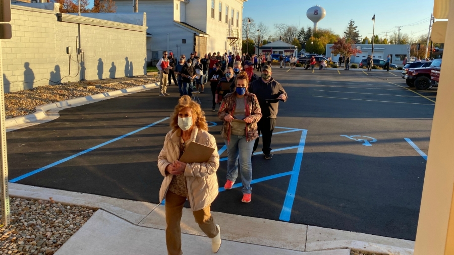 People line up in Paw Paw to vote during the Nov. 3, 2020 election.