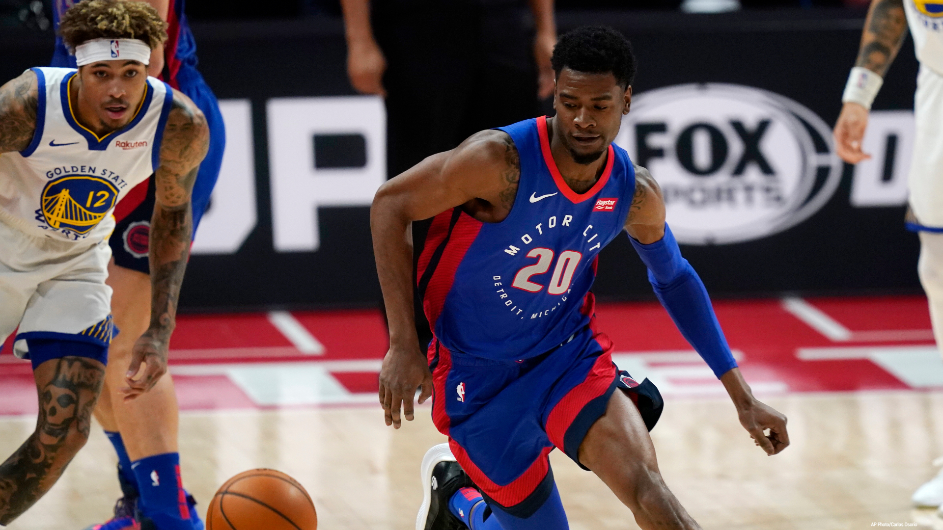 Detroit Pistons forward Josh Jackson (20) chases a loose ball during the first half of the team's NBA basketball game against the Golden State Warriors, Tuesday, Dec. 29, 2020, in Detroit. (AP Photo/Carlos Osorio)