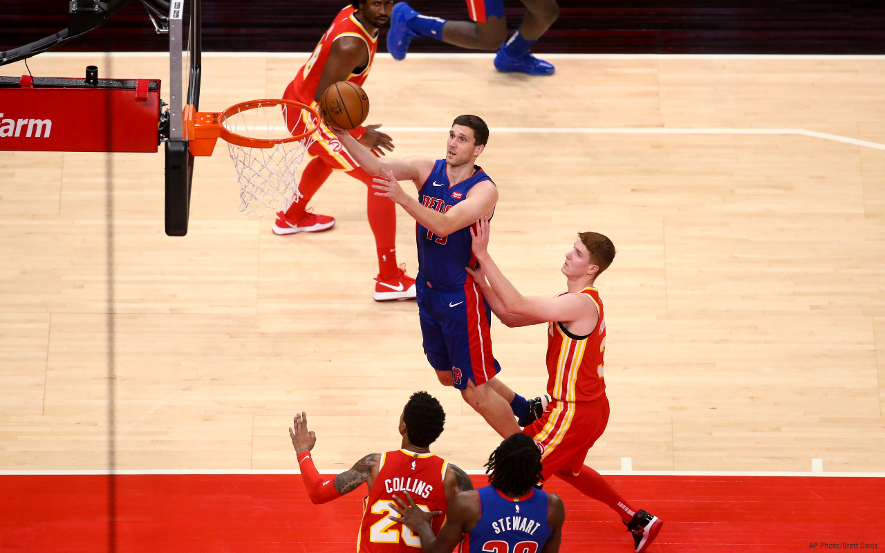 Detroit Pistons guard Svi Mykhailiuk (19) shoots past Atlanta Hawks guard Kevin Huerter (3) during the first half of an NBA basketball game Monday, Dec. 28, 2020, in Atlanta. (AP Photo/Brett Davis)