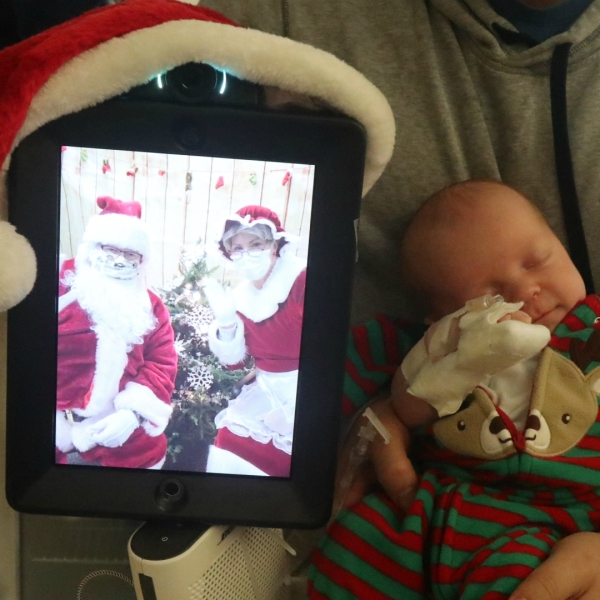 Santa and Mrs. Claus use a robot to visit kids at Bronson Children's Hospital on Dec. 16, 2020. (Courtesy of Bronson Healthcare)