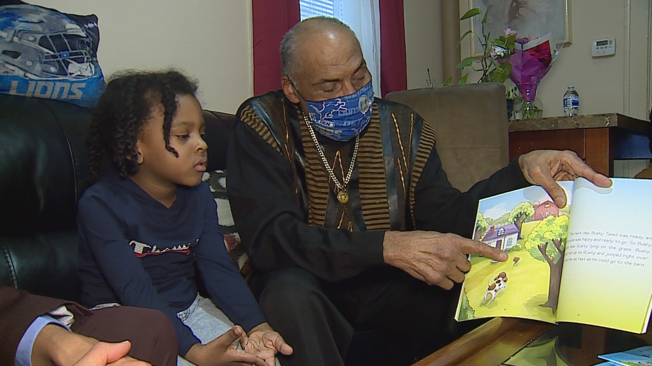 """Hilton Nelson Jr. reading his book """"Bushy Tail One Pond at a Time"""" to a child on Jan. 14, 2021."""