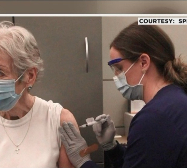 Kelsey Zoodsmaadministers the COVID-19 vaccine to her grandmotherPeggy Alexander on Jan. 14, 2021. (Courtesy of Spectrum Health)