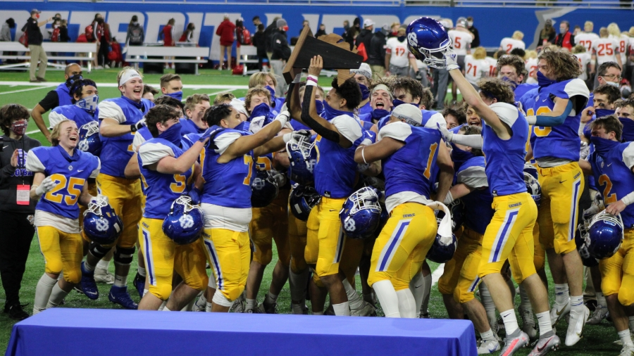 The Grand Rapids Catholic Central football team after winning the Division 5 state title at Ford Field on Jan. 23, 2021.
